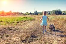 Little Girl Walking With Dog O...