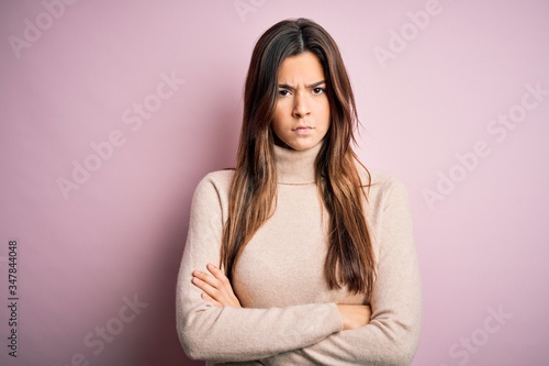Fototapety, obrazy: Young beautiful girl wearing casual turtleneck sweater standing over isolated pink background skeptic and nervous, disapproving expression on face with crossed arms. Negative person.