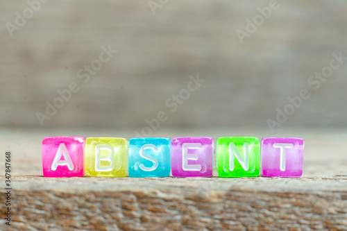 Clear bead with white letter in word absent on wood background Canvas Print