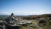 Heap Of Stones With Scenic View Ilkley Moor Against Sky