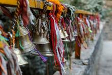 Metal Bells Hang On Chains In ...