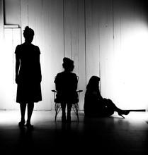 Silhouette Sisters In Darkroom