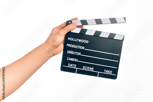Obraz na plátně Hand of caucasian young filmmaker man holding clapboard over isolated white back