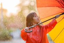 Asian Girl Opens An Umbrella O...