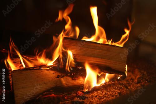 Obraz na plátně Fireplace with burning wood, closeup view. Winter vacation
