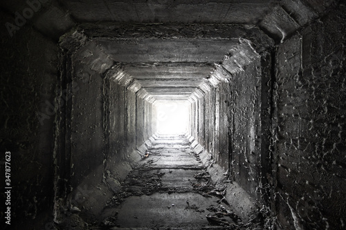 Empty square concrete tunnel with light in the end Slika na platnu