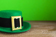 Leinwanddruck Bild - Green leprechaun hat on wooden table, space for text. St. Patrick's Day celebration