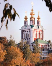 Low Angle View Of Novodevichy Convent By Trees Against Sky