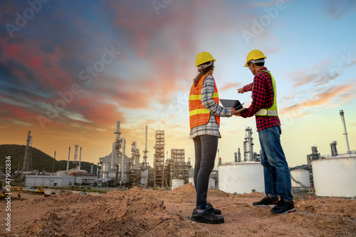 Fotomural Refinery industry engineer  wearing PPE Working at refinery construction site