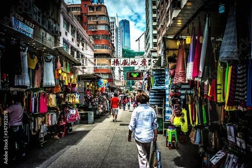 Rear View Of People Walking On Street At Market In City © katsuaki shoda/EyeEm