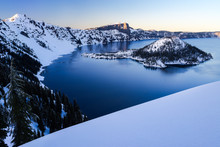 Scenic View Of Crater Lake And Wizard Island During Sunset