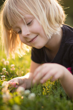 Young Girl Plays In The Grass ...