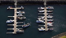 Aerial Shot Of Small Fishing Boats In The Harbour Of Keflavik