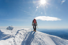 A Man Climbs To The Summit Of ...