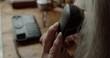 Elderly woman measuring pressure with digital sphygmomanometer