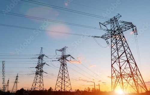 Obraz Electrical substation silhouette on the dramatic sunset background - fototapety do salonu