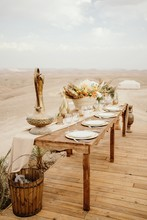 Long Wooden Table Decorated Wi...