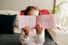 Unrecognizable Little Girl Dem...