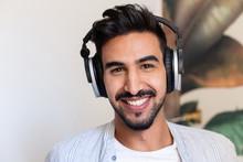 Happy Ethnic Guy In Headphones...