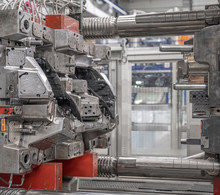 Metal Press For Plastic Castings For The Automotive Industry In The Factory. Industry 4.0