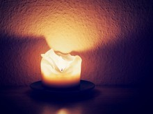 Close-up Of Lit Candle On Table