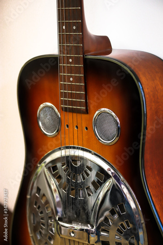 Obraz Detail of a dobro, resophonic guitar, dark brown resonator guitar. - fototapety do salonu