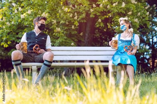 Fototapeta Social distancing in Bavaria at the beer garden obraz