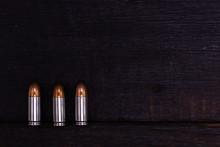 9 Mm Ammunition On A Black Bac...