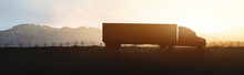 Panoramic - Silhouette Of Truck Driving Through The Mountains