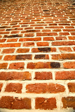 Low Angle View Of Red Brick Wall