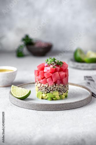Cuadros en Lienzo Tuna tartare tartar with avocado and quinoa