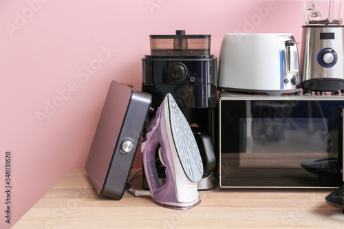 Different household appliances on table Wallpaper Mural