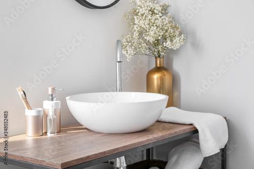Interior of bathroom with fresh flowers Fototapeta