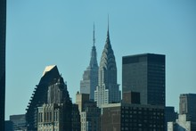 Chrysler Building And Empire State Building Against Clear Blue Sky