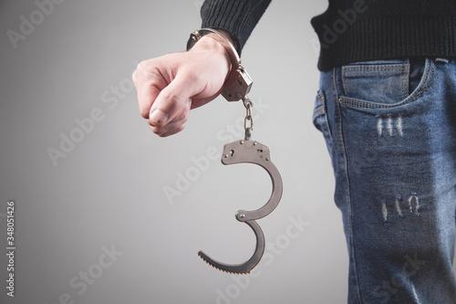Caucasian man hand in handcuffs. Arrest Canvas Print