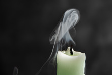 Smoke From A Candle On A Black...