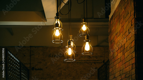 Low Angle View Of Illuminated Pedant Lights Hanging From Ceiling Fototapet