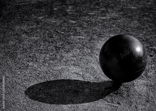 Close-up Of Black Ball On Ground Fotobehang