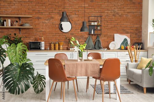 Fototapeta Interior of modern stylish dining room with floral decor obraz