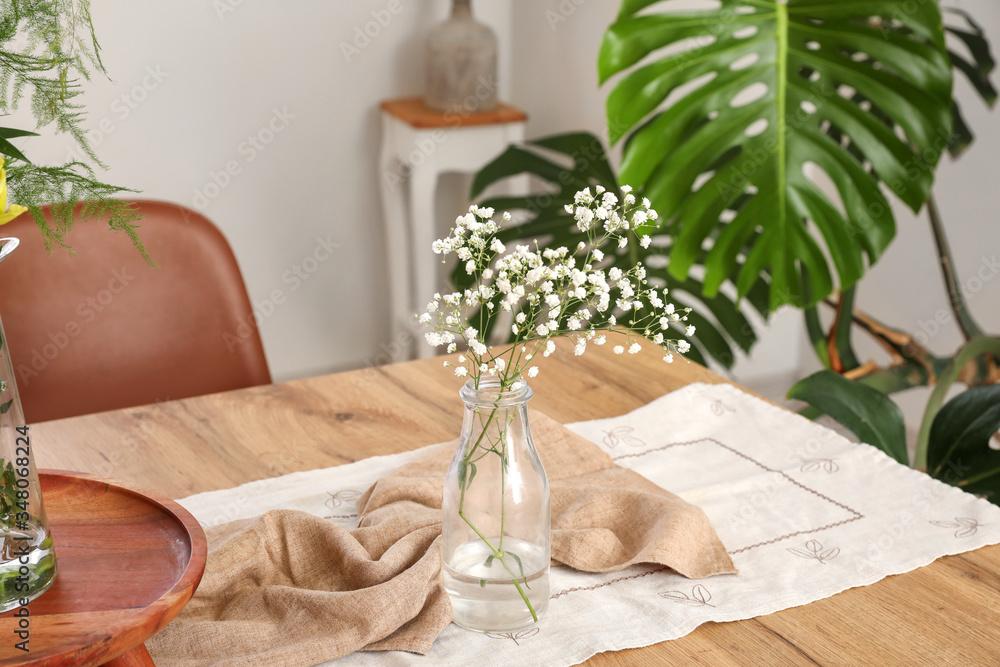 Fototapeta Floral decor on table in dining room