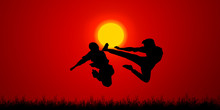 Silhouette Of A Couple Jumping...