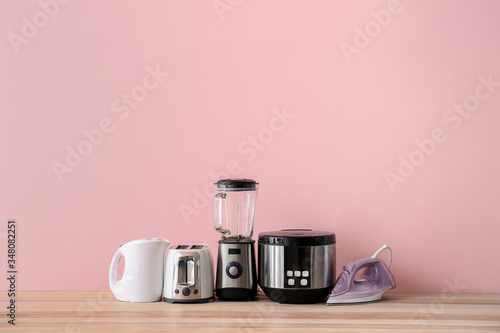 Photo Different household appliances on table