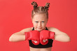 canvas print picture - Little girl in boxing gloves on color background