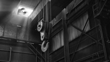 Low Angle View Of Pulley In Abandoned Factory