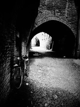 Bicycle Parked On Cobbled Street