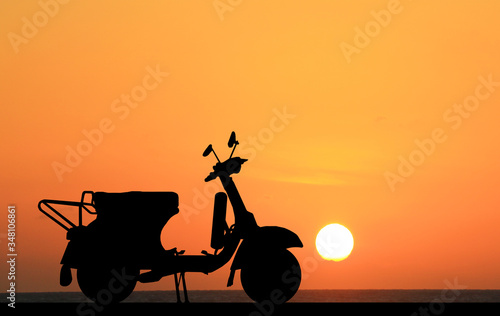 silhouette classic motocycle on sunrise background Canvas Print