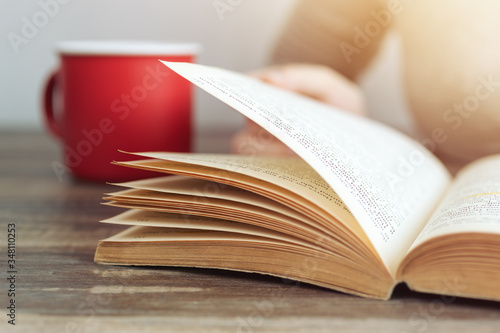 Vintage close up of an old open book with yellow pages Canvas Print