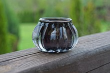 One Small Black Glass Vase Sta...