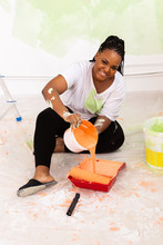 Happy Smiling African American Woman Painting Interior Wall Of New House. Redecoration, Renovation, Apartment Repair And Refreshment Concept.