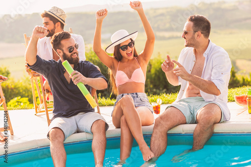 Obraz People having fun at poolside party - fototapety do salonu